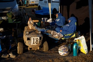 The Team Phoenix mower lies in the pits while the team members sleep.