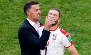 Serbia coach Mladen Krstajic celebrates after a win, with  Branislav Ivanovic