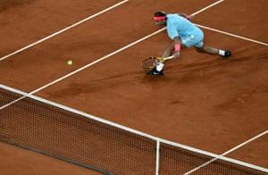 Nadal reaches for a return.
