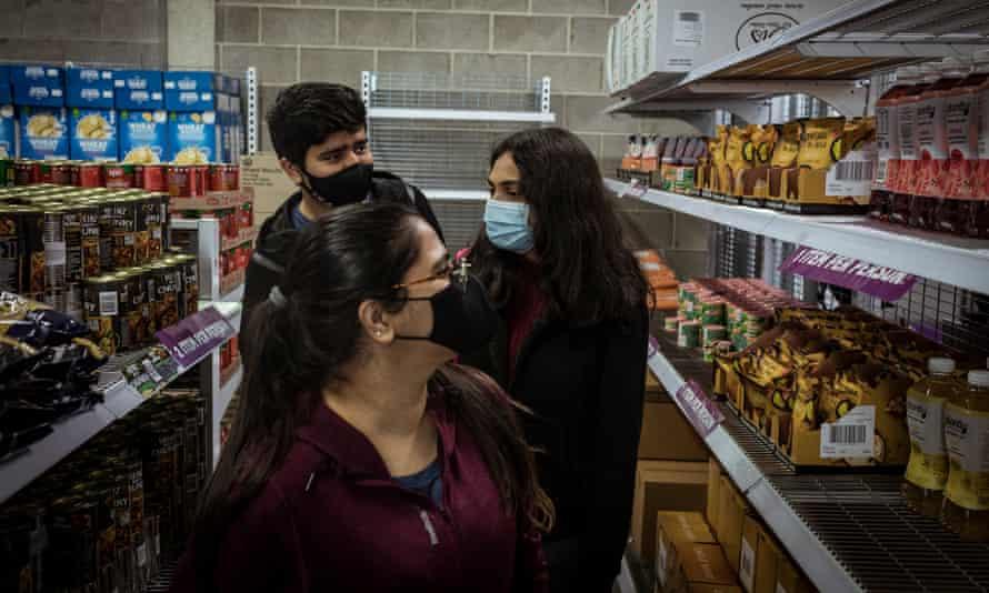 Kush Chandarana, Meghna Ganesh and Kanishka Chaudhray pick up groceries at Foodbank
