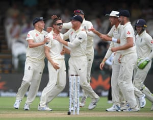 England bowler Joe Denly (2nd left) is congratulated by team mates after taking the wicket of South Africa batsman Dean Elgar after review.