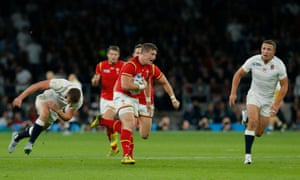 Scott Williams escapes the tackle from Owen Farrell as he makes it to the England 22