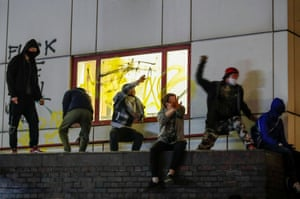 Demonstrators throw objects during the protest.