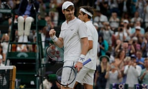 Andy Murray celebrates victory in the first round of the Wimbledon men's doubles alongside France's Pierre-Hugues Herbert.