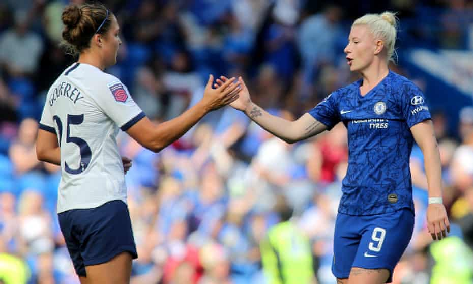 Tottenham's Hannah Godfrey shakes hands with Beth England of Chelsea, who would win the title on a points per game system if the league ended early.