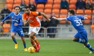 Blackpool's Curtis Tilt gets away from Portsmouth's Kyle Bennett and Ben Close.