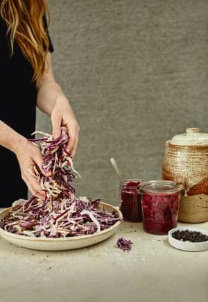 Preparing cabbage for a quick slaw or sauerkraut.