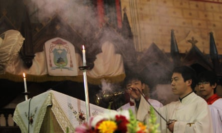 A priest conducts rites during a Catholic mass at Xishiku Cathedral in Beijing. There are an estimated 67 million Christians in China.
