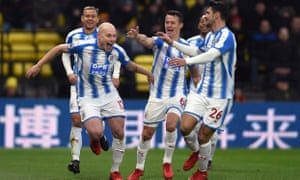 Aaron Mooy celebrates scoring Huddersfield's second goal against Watford.