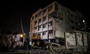 The scene where a bomb detonated next to a national security building in the Shubra neighbourhood of Cairo.