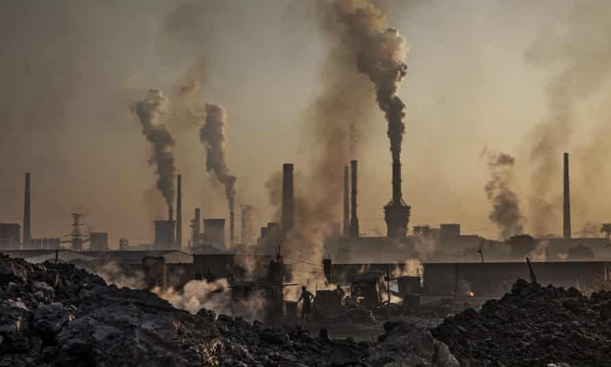 Smoke billows from a large steel plant as labourers work at an unauthorised steel factory in Inner Mongolia, China.