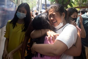 Yangon, Myanmar. Relatives greet protesters being released at Tamwe township police station after being detained by police during the anti-coup demonstrations