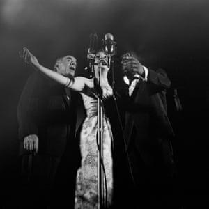 Jon Hendricks, right, performing with the trio Lambert, Hendricks and Ross at the Newport jazz festival, 1959.