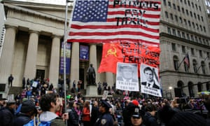 Demonstrators protest against tax cuts next to the New York Stock Exchange on Saturday.