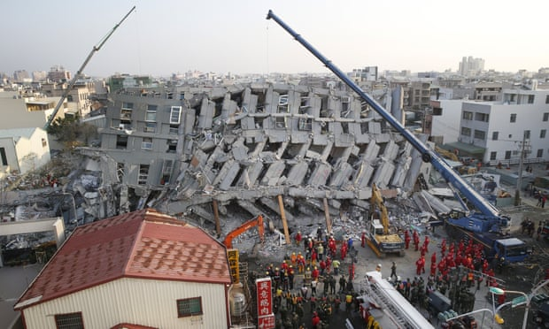 Rescuers search for dozens missing in the collapsed apartment building in Tainan on Sunday. Photograph: Wally Santana/AP