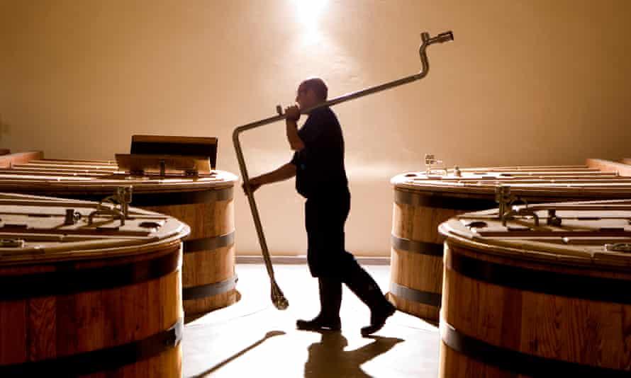 Man in a whisky distillery Scotland.