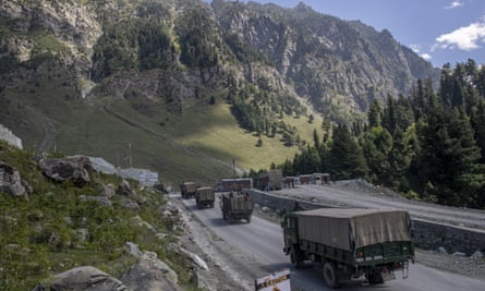 an Indian army convoy moves on the Srinagar- Ladakh highway at Gagangeer, northeast of Srinagar, Indian-controlled Kashmir.