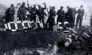 A group of men in the District of Columbia destroying a consignment of beer recently arrived from Philadelphia, 1923.