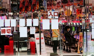 Visitors play pachinko, a Japanese form of legal gambling, at a pachinko parlour, after the government announced nationwide state of emergency following the coronavirus outbreak, in Tokyo, Japan 22 April 2020.