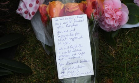Flowers and a note are seen at a growing makeshift memorial for Eurydice Dixon at the Princes Park sporting precinct, Melbourne, 15 June 2018.