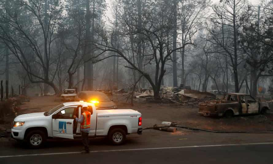 Employees of Pacific Gas & Electric work in the aftermath of the Camp fire in Paradise.