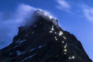 Zermatt, Switzerland Lamps illuminate the path of the first ascent on the Matterhorn mountain