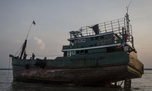 A boat which carried Rohingya and Bangladeshi migrants sits abandoned in Kuta Binje, Aceh, Indonesia, on Wednesday.