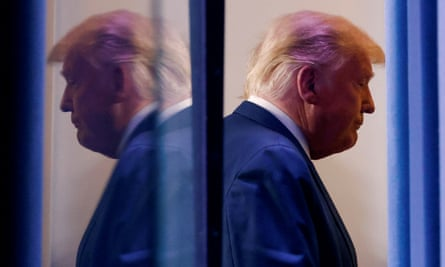 Donald Trump is reflected as he departs after speaking at the White House in Washington DC Thursday.