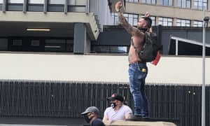 A man climbs on top of Colston's former plinth during a protest in Bristol.