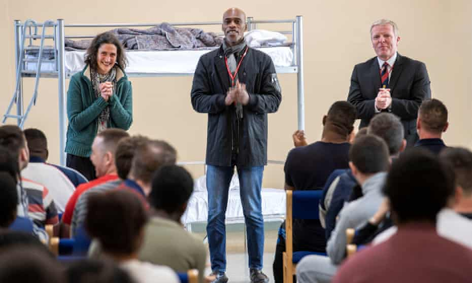 Director Moira Hunt, Chris Lewis and prison governor Steve Hodson address inmates at Portland
