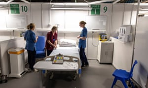Staff prepare to receive patients at Scotland's Covid-19 facility at NHS Louisa Jordan, Glasgow.