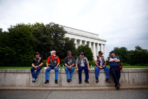 Spectators are seen as motorcyclists participate in Rolling Thunder, the annual ride around Washington Mall