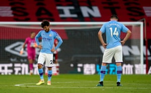 Manchester City's David Silva (left) and Aymeric Laporte stand dejected.