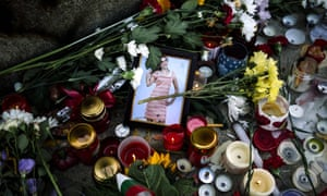 Flowers and candles are placed near a portrait of slain Bulgarian television journalist Viktoria Marinova in the city of Rousse.