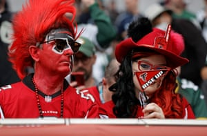 A pair of Falcons fans enjoying the game atmosphere.