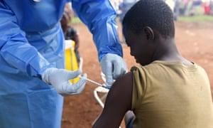 A boy receives the Ebola vaccine in North Kivu.