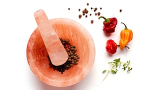 Grind whole allspice berries.
