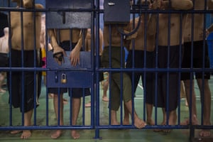Bangkok, Thailand Foreign detainees stand behind bars at an immigration detention centre in Bangkok during a visit organised by authorities for journalists. Rights groups have for years condemned Thailand, which is not a signatory to the UN's convention protecting refugees, for its hostility to asylum seekers, often trapping them on a carousel between detention and work in the black economy.