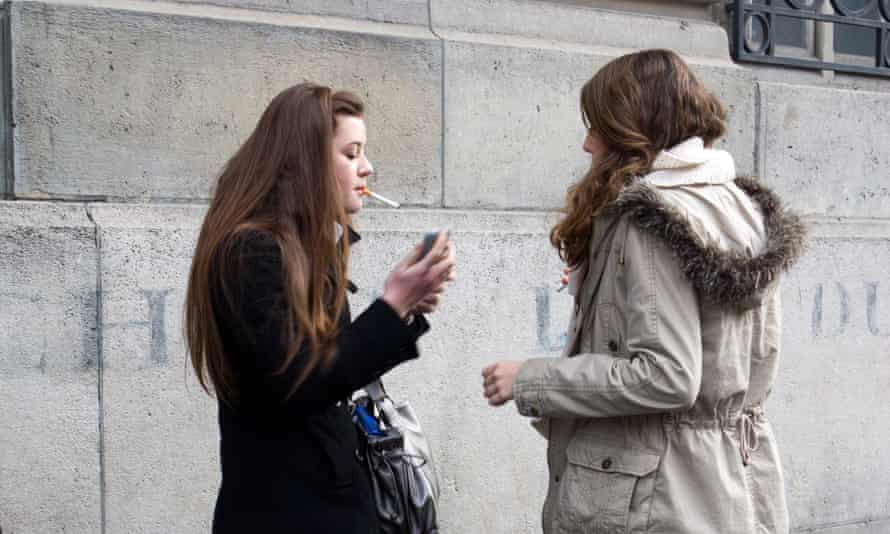 Young smokers gathered outside a Paris school