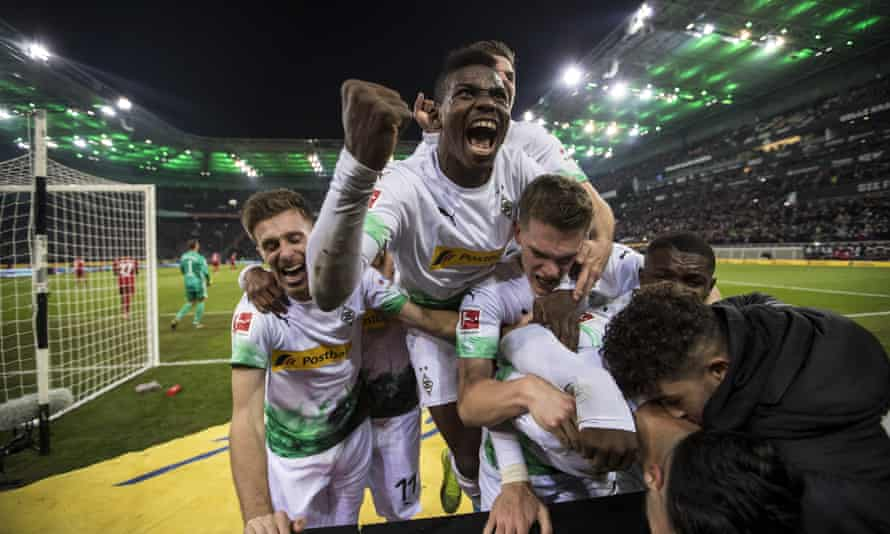 Borussia Mönchengladbach players celebrate one of Ramy Bensebaini's goals.