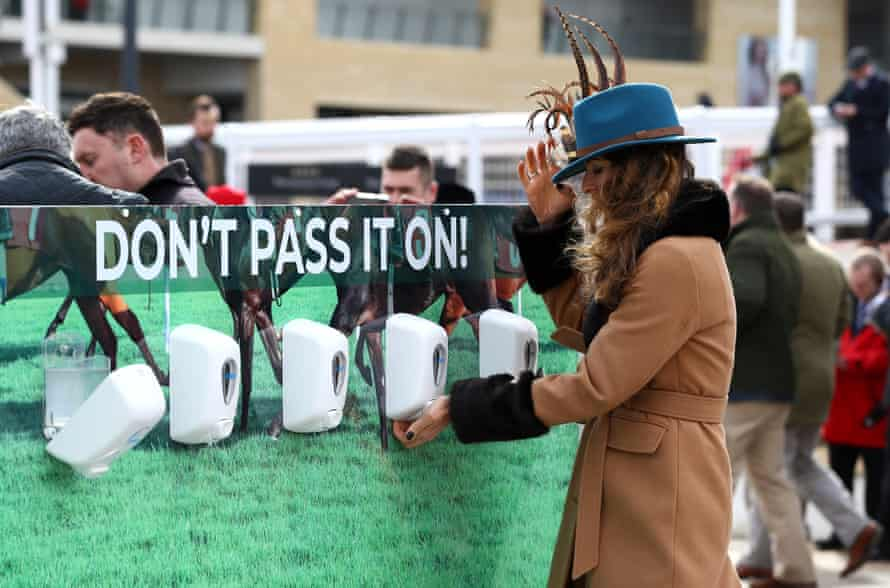 Race-goers use hand sanitiser installed at Cheltenham Racecourse to help curb the spread of the Corona Virus at Cheltenham Racecourse on March 10, 2020 in Cheltenham, England.