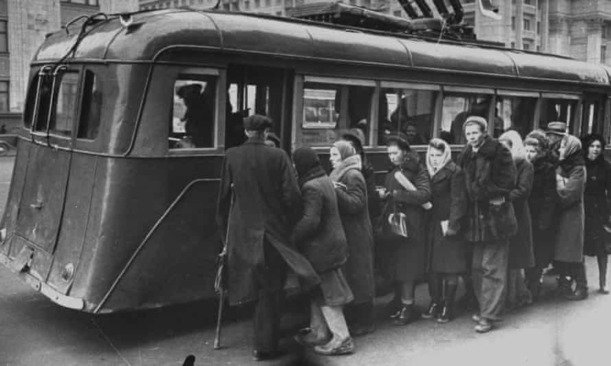 People loading into the electric trolley bus.