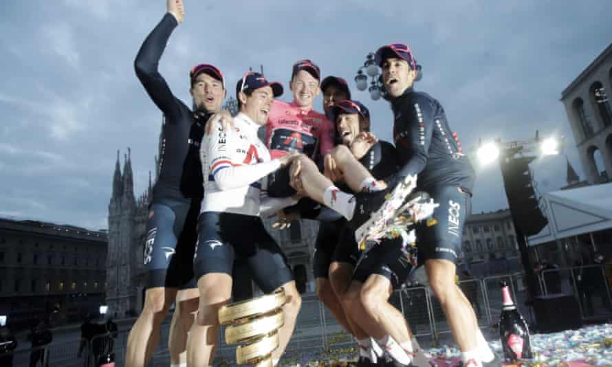 Tao Geoghegan Hart celebrates with his Ineos Grenadiers teammates after winning the Giro d'Italia.