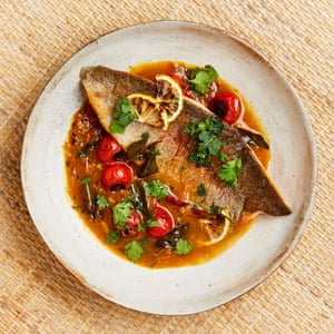 Yotam Ottolenghi's rainbow trout in spicy tomato and tamarind rasam sauce.