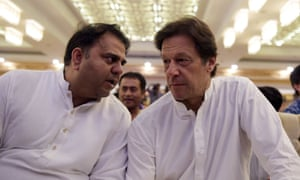Spokesperson for the Pakistan Tehreek-i-Insaf party Fawad Chaudhry (L) speaks to head of the party Imran Khan (R).