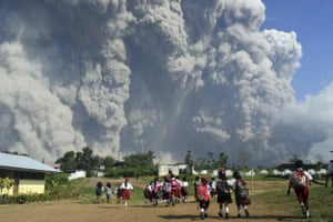 School children look up at the Mount Sinabung ash plume.