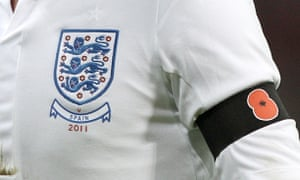 England player wearing a black armband with a poppy symbol
