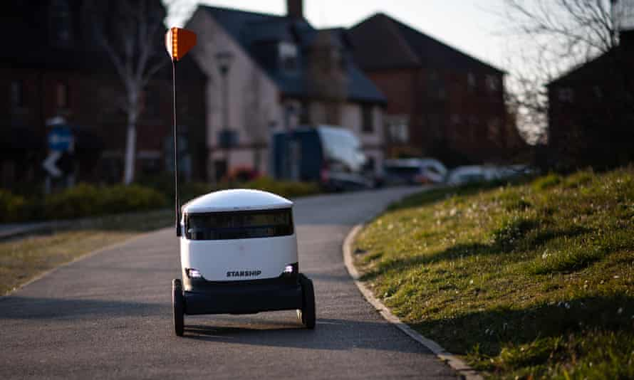 A Starship Technologies delivery robot makes a home delivery in Milton Keynes.