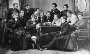 Chekhov reads The Seagull to actors of the Moscow Art Theatre, 1899, with Olga Knipper standing to his left; Vladimir Nemirovich-Danchenko stands far left.Nemirovich-Danchenko stands far left.