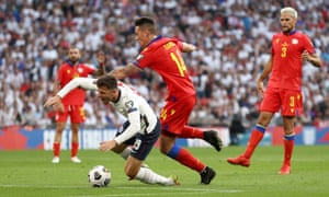 Mason Mount of England is brought down by Christian Garcia of Andorra.